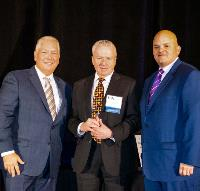 Remke President Mark Sweeney receives the IMA's Legacy Award